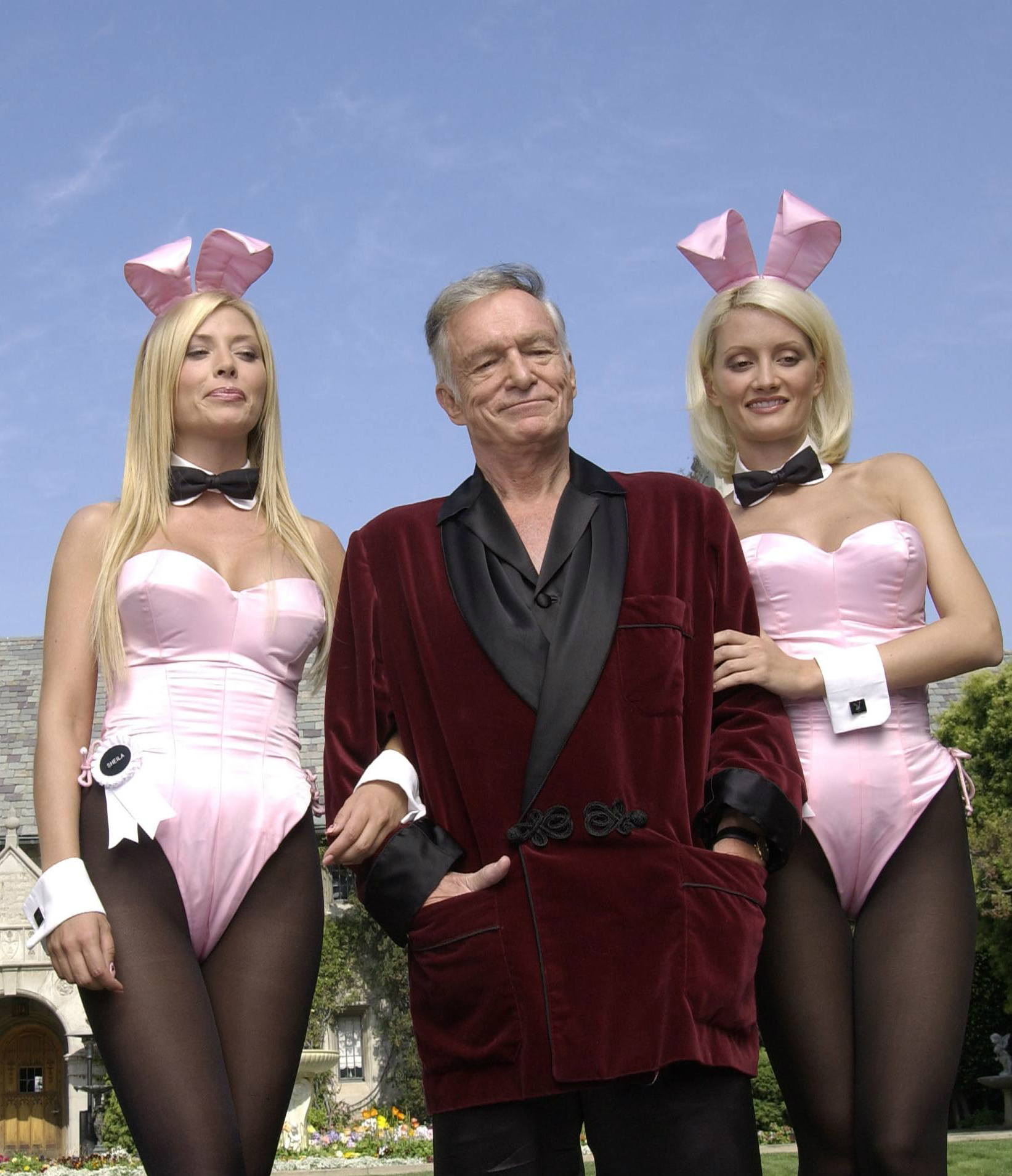 Hugh Hefner with two bunnies at the Playboy Mansion, 2003