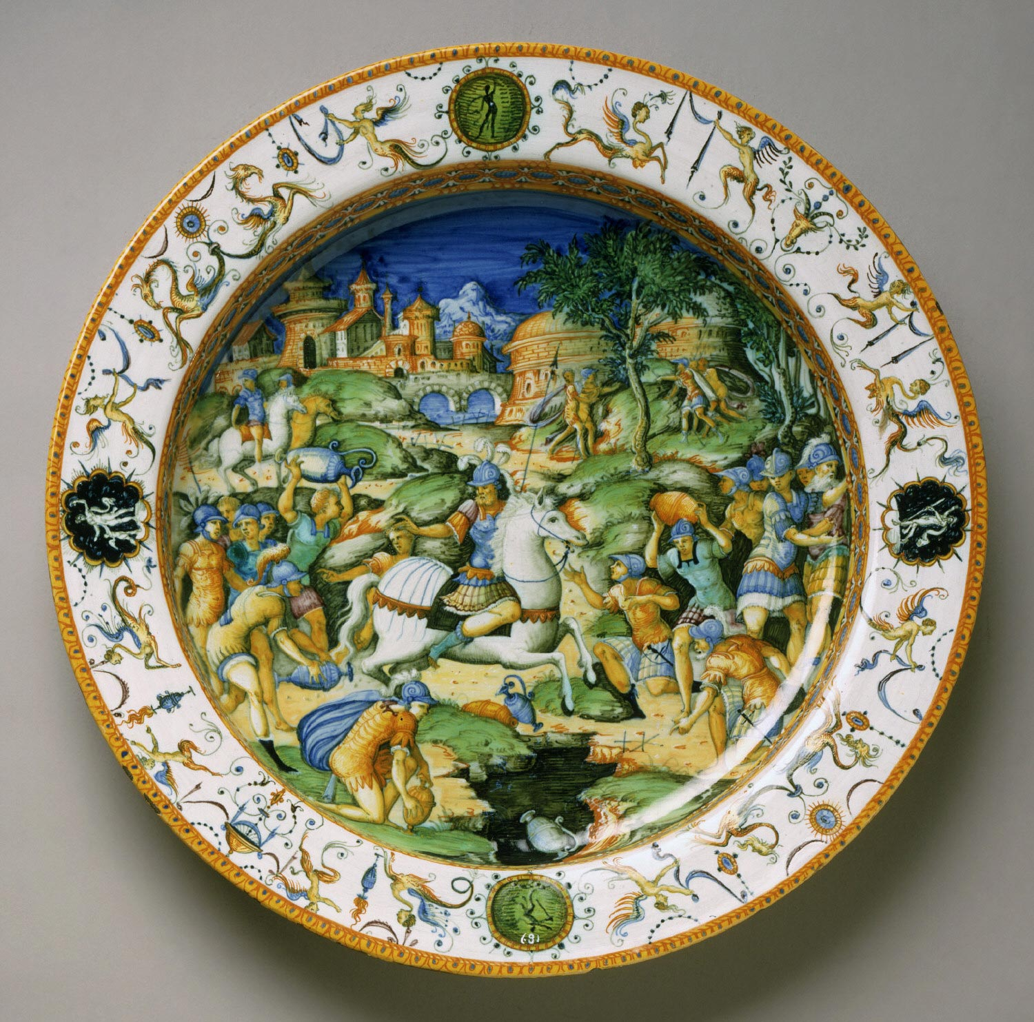 A maiolica plate showing the sacrifice of Marcus Curtius, cr. 1560-1570, workshop of Guido Durantino or of Orazio Fontana, Urbino