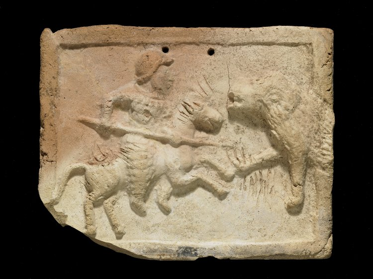 Plaque showing a heavily armoured horseman (cataphract) spearing a lion, 3rd century BC - 2nd century, Parthian or Seleucid