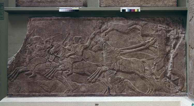 Gypsum wall panel relief showing an Assyrian official in a chariot pursuing enemy horsemen,865 BC-860 BC, Neo-Assyrian (Iraq)