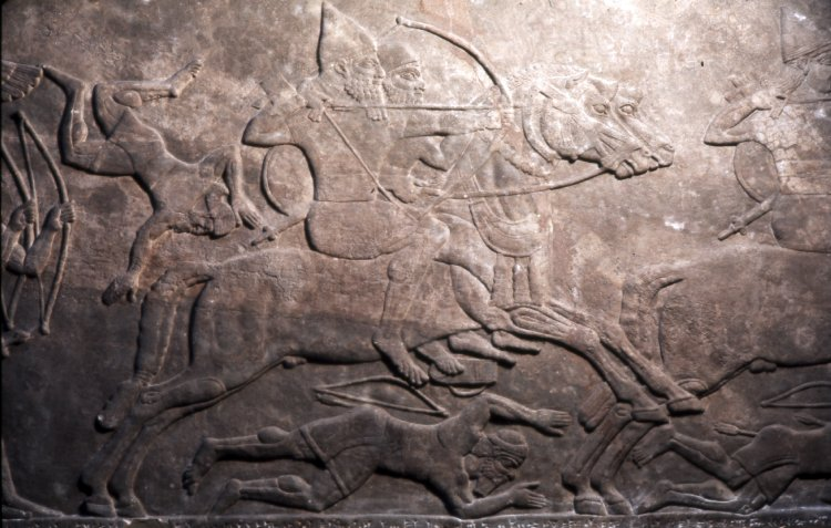 Gypsum wall panel relief showing Assyrian cavalry and infantry attacking the enemy,865 BC-860 BC, Neo-Assyrian (Iraq)