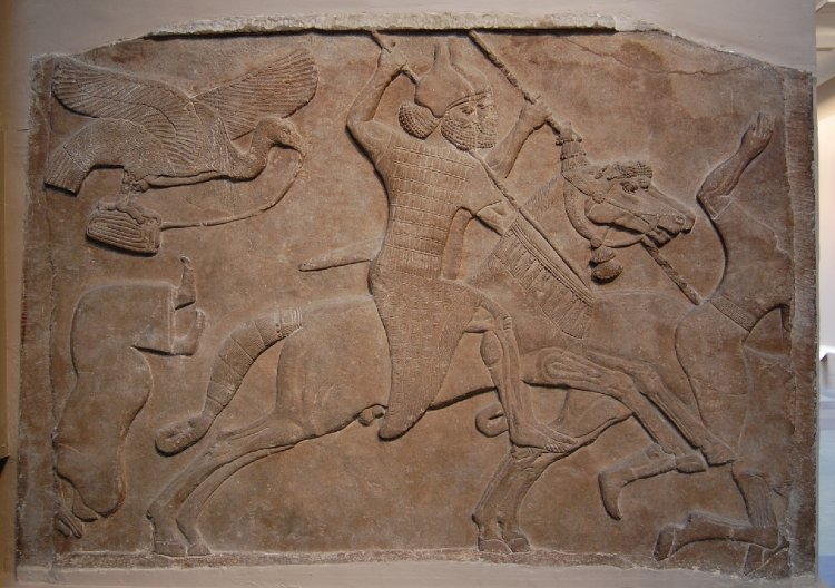 Wall panel relief depicting two Assyrian cavalrymen charging against enemies, cr. 728 BC, Neo-Assyrian (Iraq)