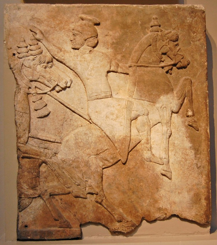 Wall panel relief depicting a horseman attacked by two mounted Assyrians, cr. 728 BC, Neo-Assyrian (Iraq)