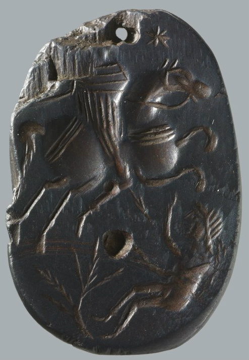 Magical gem with a rider on a rearing horse (Solomon) stabbing a woman lying on the earth (Lilith), 4th century