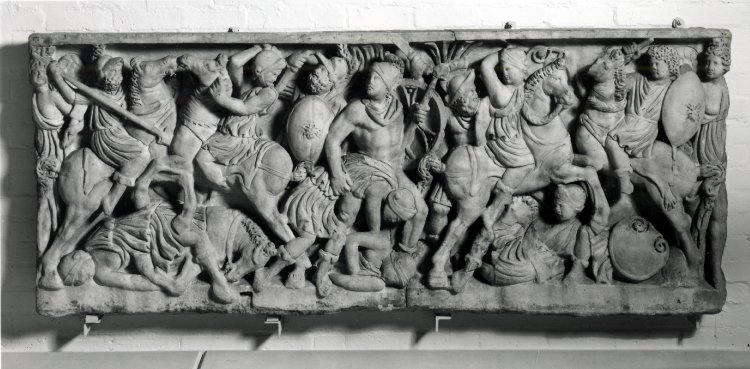 A piece from the front of a lenos (tub-shaped sarcophagus) with a battle between Greeks and Amazons, cr. 290-310, Rome