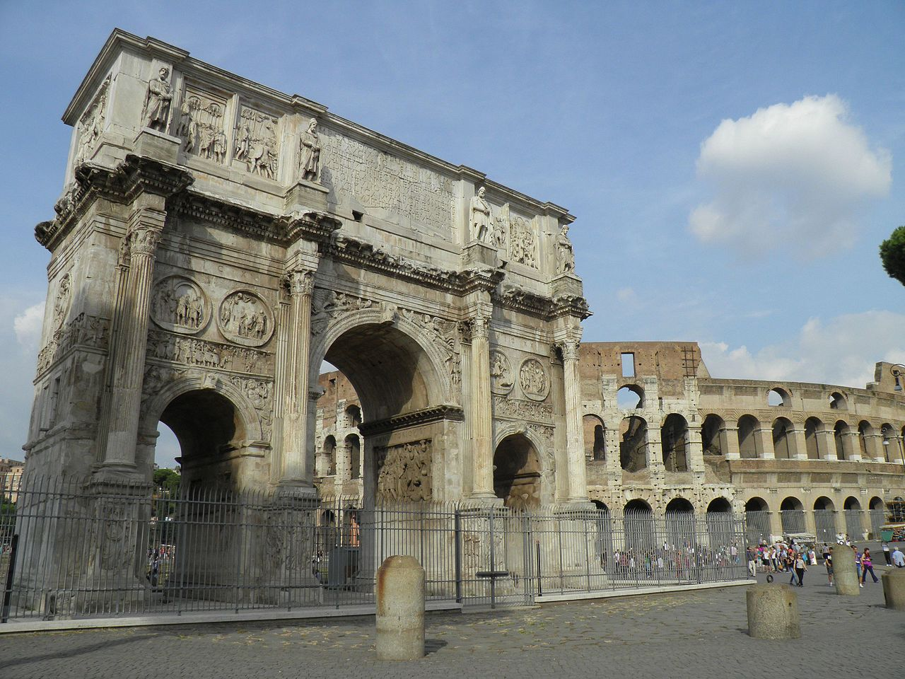 Arch of Constantine and Colosseum in the background, 315, Rome