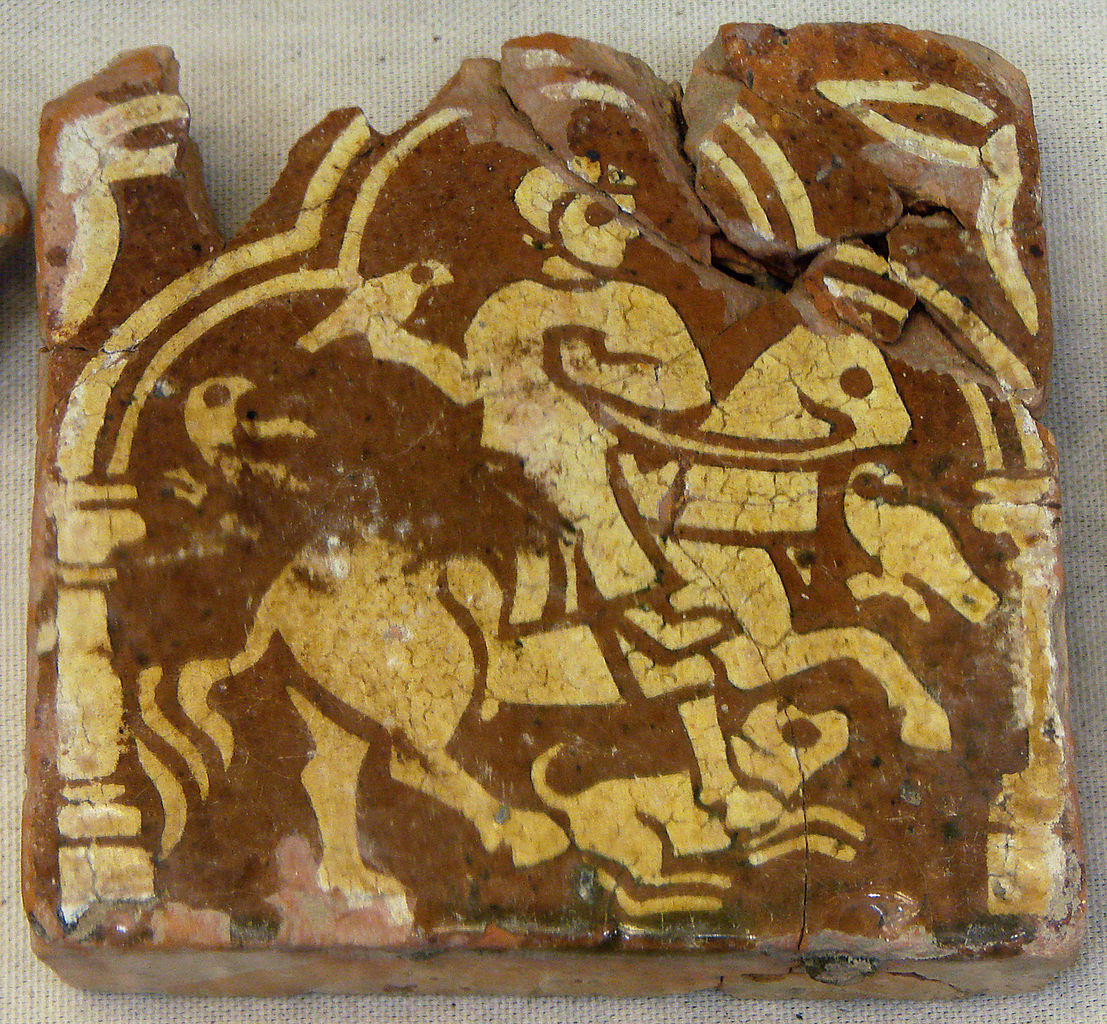 Inlaid tile showing a hunter with a dog, 13th-15th century, Laon region, France