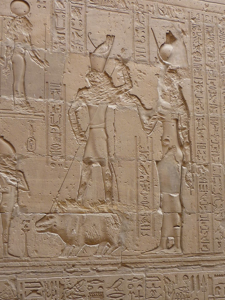 COMPARANDUM: Wall relief of fight between Set and Horus where Horus spears Set (hippopotamus), Temple of Edfu, Egypt, 237 BC - 57 BC