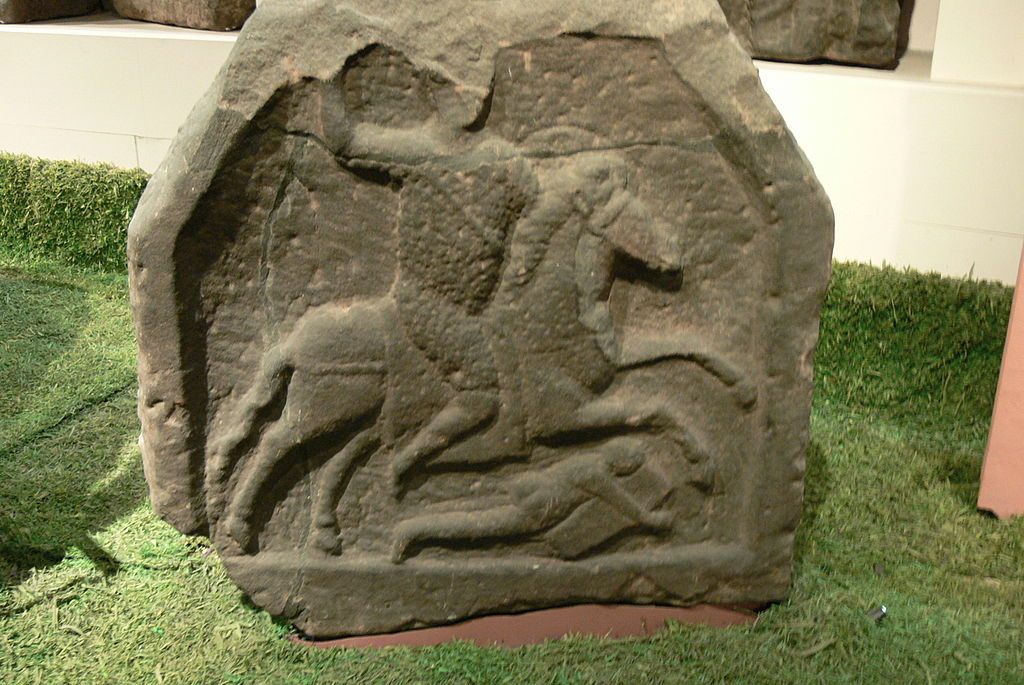 Roman gravestone showing a cavalryman and naked barbarian lying beneath the horse's hooves, ?, discovered in Chester, UK