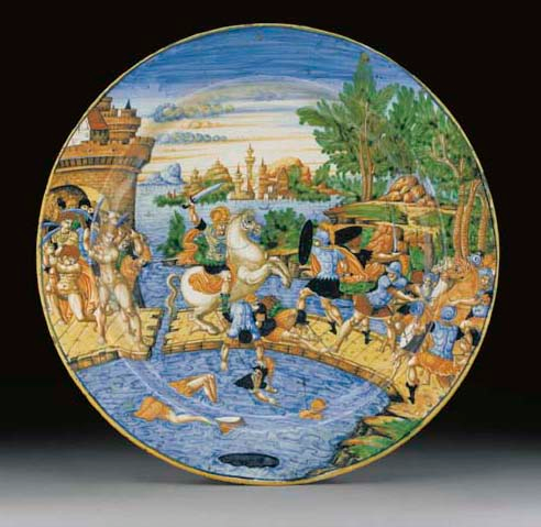 A maiolica plate showing a battle on a drawbridge, cr. 1540, the workshop of Guido da Merlingo, Urbino