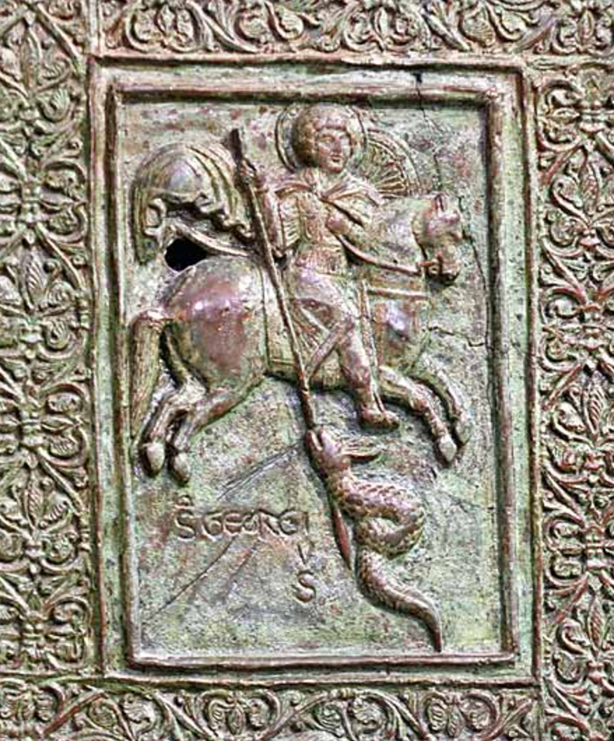 St. George killing the dragon, detail of the main doors, 1185, Trani Cathedral, Puglia