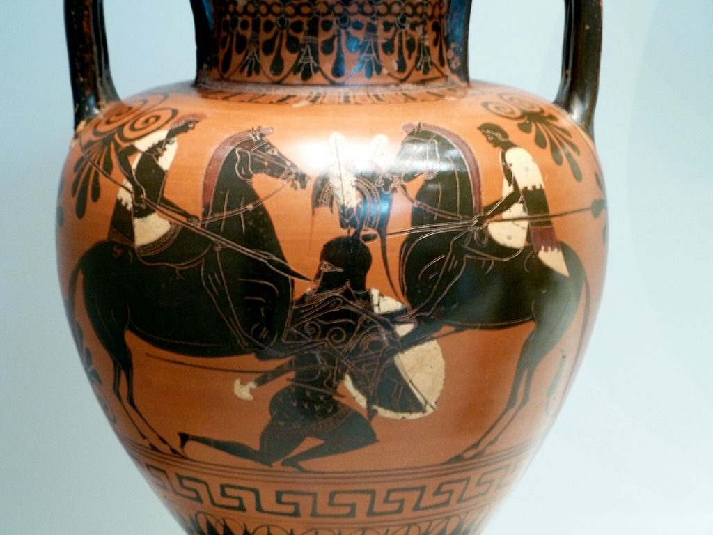Amphora with a battle scene in which a hoplite, or heavily armed infantryman, falls to the ground between two cavalrymen,cr. 530-520 BC, Attic