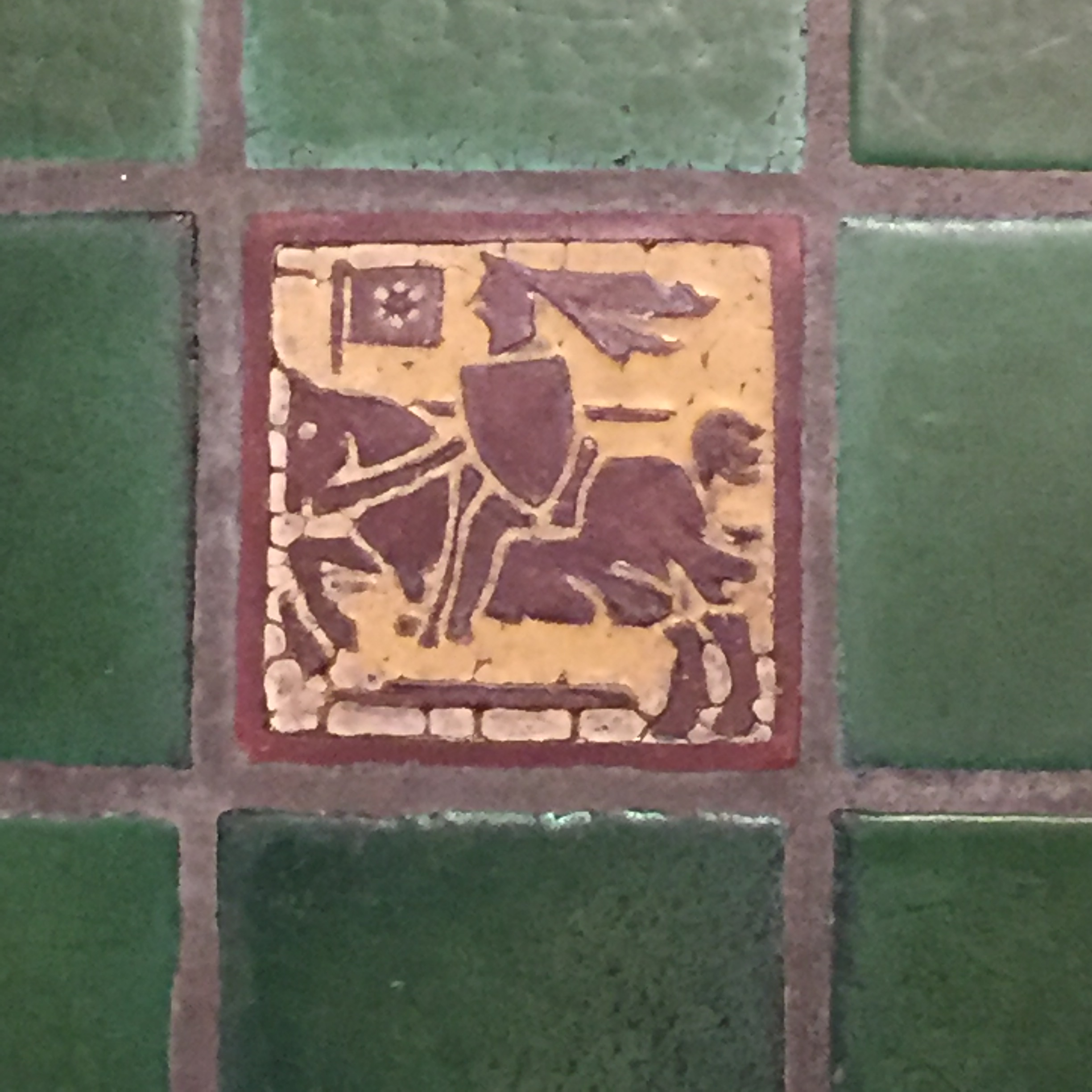Floor tile showing a knight on horseback (still decorating a floor), cr. 1910, Grueby Faience Company, U.S.A.